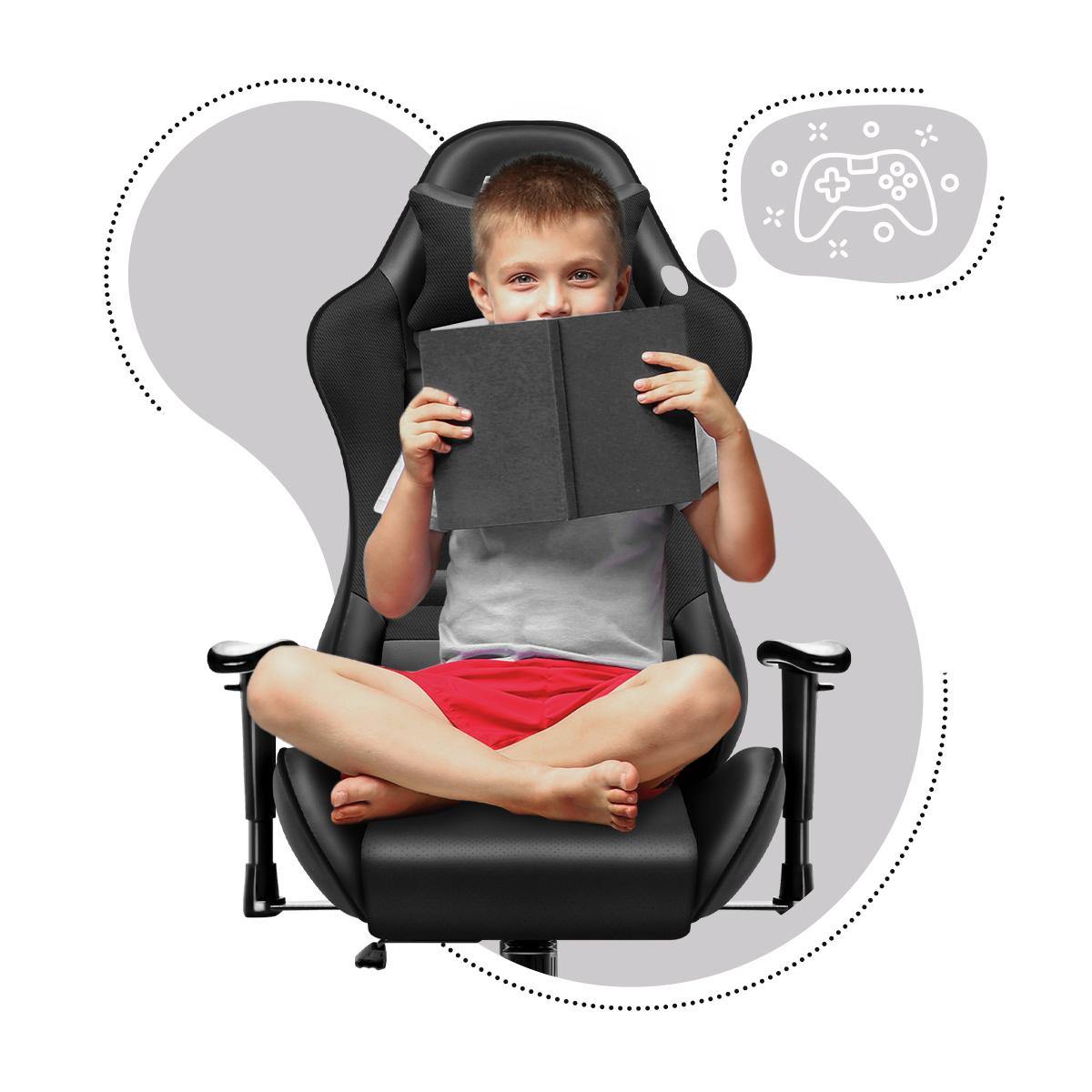 Dziecko siedzące z książka na fotelu dziecięcym Huzaro Ranger 6.0 Black